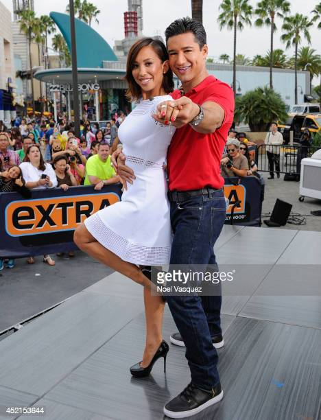 Cheryl Burke and Mario Lopez visit 'Extra' at Universal Studios Hollywood on July 14 2014 in Universal City California