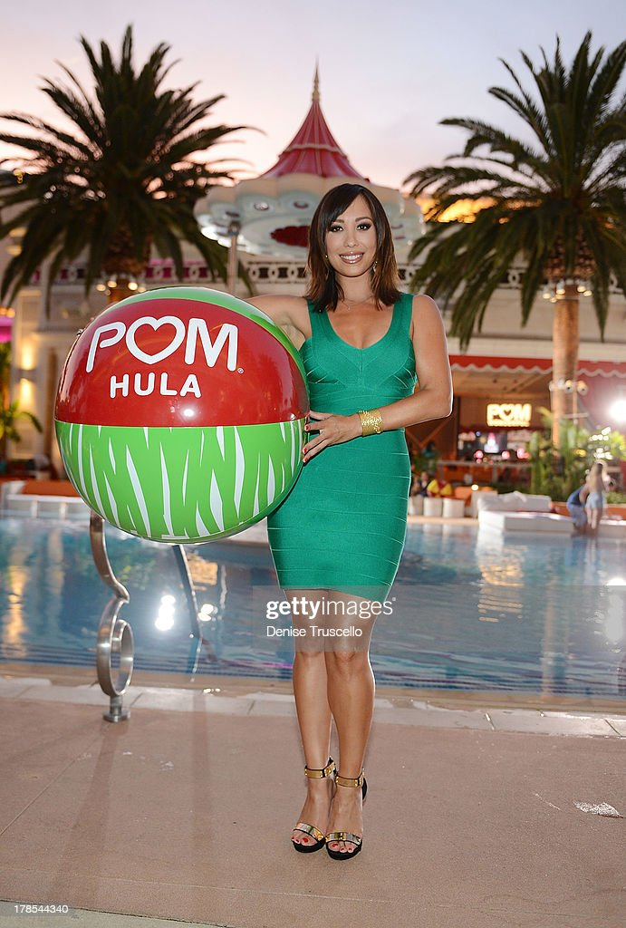 <a gi-track='captionPersonalityLinkClicked' href=/galleries/search?phrase=Cheryl+Burke&family=editorial&specificpeople=540289 ng-click='$event.stopPropagation()'>Cheryl Burke</a> celebrates POM Wonderful's launch of three new 100% Juice Blends by leading 125 people in setting the Guinness World Record for the longest beach-ball bounce in history at the Encore Beach Club at Wynn Las Vegas on August 29, 2013 in Las Vegas, Nevada.