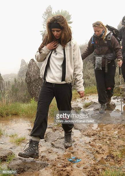 Cheryl Cole and Kimberley Walsh trek in the rain on the fifth day of The BT Red Nose Climb of Kilimanjaro on March 5 2009 near Arusha Tanzania...