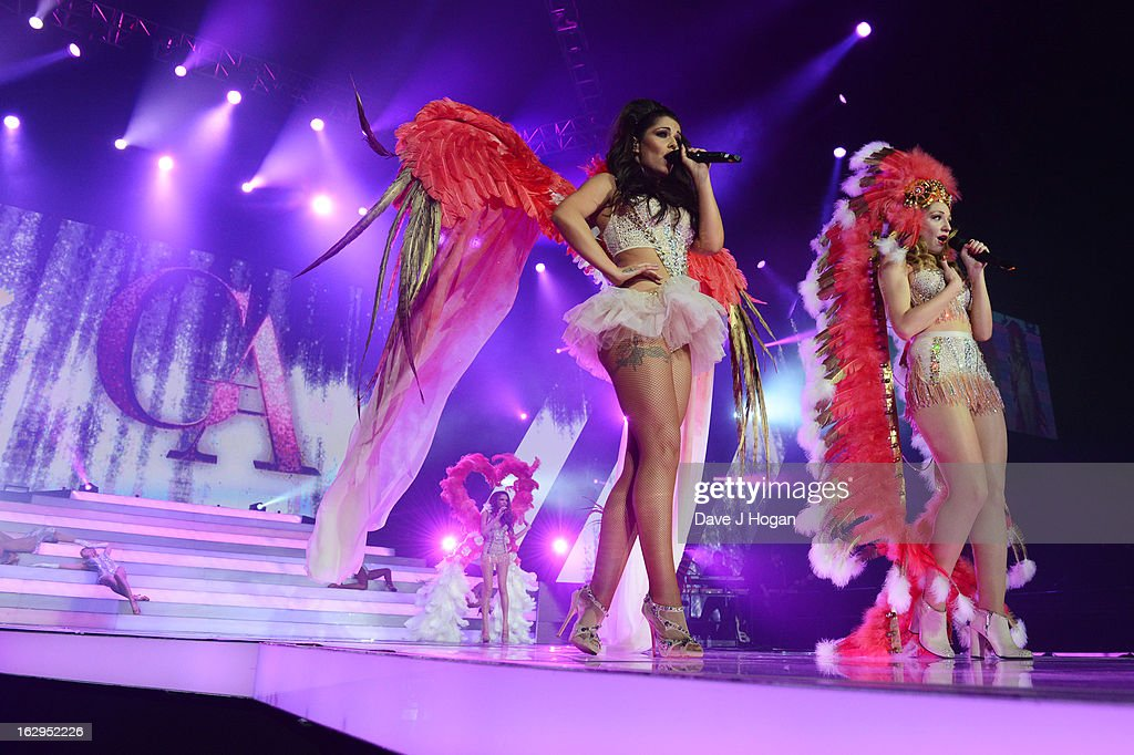 Cheryl Cole and <a gi-track='captionPersonalityLinkClicked' href=/galleries/search?phrase=Nicola+Roberts&family=editorial&specificpeople=203306 ng-click='$event.stopPropagation()'>Nicola Roberts</a> of Girls Aloud perform on their 'Ten - The Hits Tour' at The O2 Arena on March 1, 2013 in London, England.