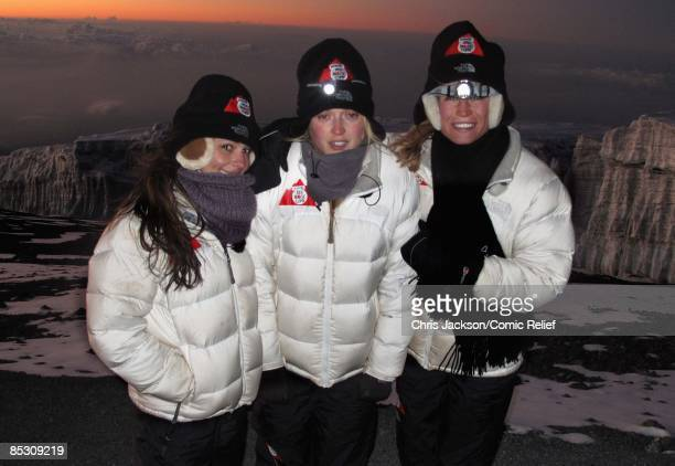 Cheryl Cole Fearne Cotton and Denise Van Outen pose for a photo in front of the Kilimanjaro Glacier as they reach the top of Mount Kilimanjaro on the...