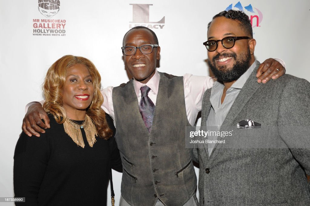 Cheryl Davis, actor <a gi-track='captionPersonalityLinkClicked' href=/galleries/search?phrase=Don+Cheadle&family=editorial&specificpeople=202096 ng-click='$event.stopPropagation()'>Don Cheadle</a> and Erin Davis arrive at Mr. Musichead Gallery for the 'Miles Davis: The Collected Artwork' Launch Party on November 7, 2013 in Los Angeles, California.