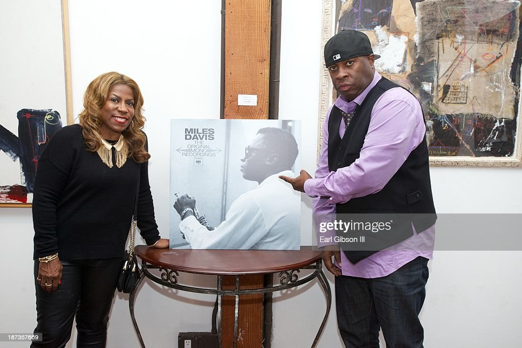 Cheryl Davis (daughter of Miles Davis) and Vince Wilburn Jr. (nephew of Miles Davis) attend the 'Miles Davis: The Collected Artwork' Launch Party at Mr. Musichead Gallery on November 7, 2013 in Los Angeles, California.