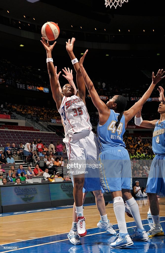 Cheryl Ford of the Detroit Shock puts up a shot under pressure against Chasity Melvin of the Chicago Sky during the WNBA game on July 16 2008 at The...