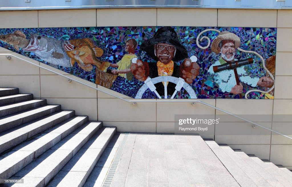 Cheryl Foster's yellow perch, large mouth bass, pumpkinseed fish and Daniel Hicks stained glass mosaic 'Maryland's Bounty, Panel 2', is displayed along the steps at the National Harbor in Prince George's County, Maryland on APRIL 20.