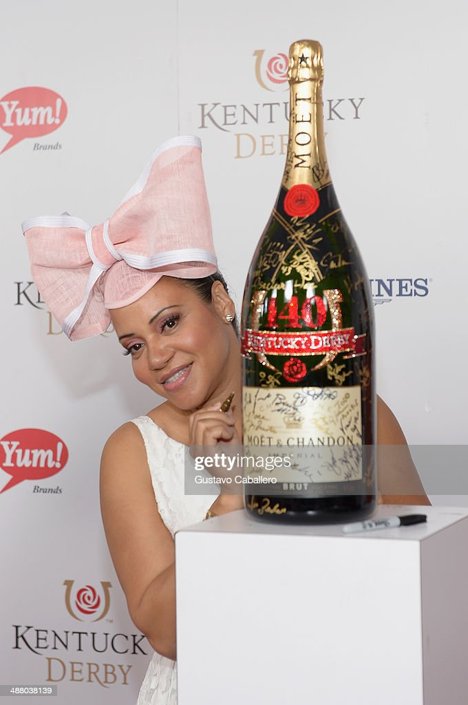<a gi-track='captionPersonalityLinkClicked' href=/galleries/search?phrase=Cheryl+James&family=editorial&specificpeople=1148224 ng-click='$event.stopPropagation()'>Cheryl James</a> toasts with Moet & Chandon at the 140th Kentucky Derby at Churchill Downs on May 3, 2014 in Louisville, Kentucky.
