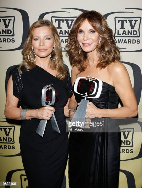 Cheryl Ladd and Jaclyn Smith pose with their Pop Culture awards for 'Charlie's Angels' backstage at the 8th Annual TV Land Awards held at Sony...