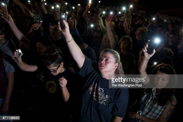 Cheryl Martinez of San Antonio sings and prays during a vigil for the victims killed in the Sutherland Springs First Baptist Church and their...