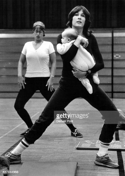 Cheryl Ruderman goes through her ski conditioning exercises with her daughter Lauren age 5 months at a class held for the upcoming ski season at...