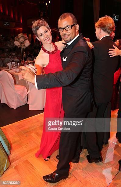 Cheryl Shepard and her partner Nikolaus Okonkwo dance during the Leipzig Opera Ball 'Let's dance Dutch' at alte Oper on September 10 2016 in Leipzig...