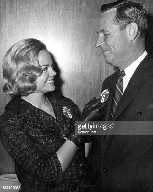 Cheryl Sweeten Miss Colorado of 1963 pins a Channel 6 'Booster' button on Gov John Love to help initiate the 1963 KRMATV membership campaign Drive...