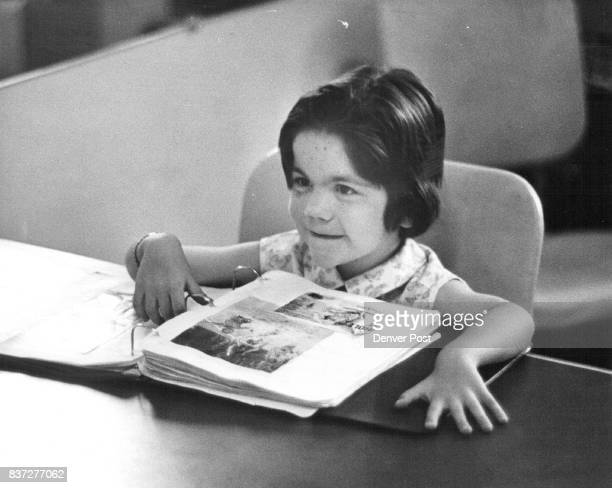 Cheryl Tams daughter of Mr and Mrs Michael Tams 1671 S Clay St seems to enjoy her session of speech therapy at Sewall This is only one of many...