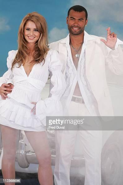 Cheryl Tweedy and Ashley Cole Tweedy is wearing a dress by Robert Cavalli