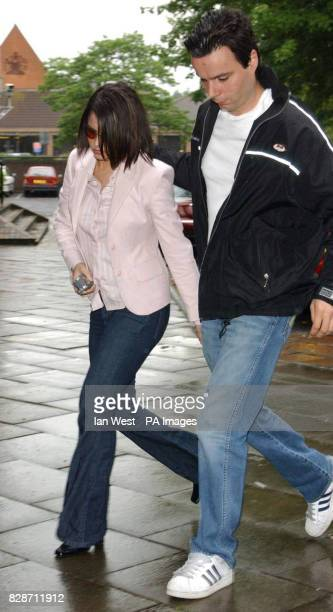 Cheryl Tweedy of pop band Girls Aloud accompanied by a minder leaves Guildford magistrates in Surrey after she was released on conditional bail * The...