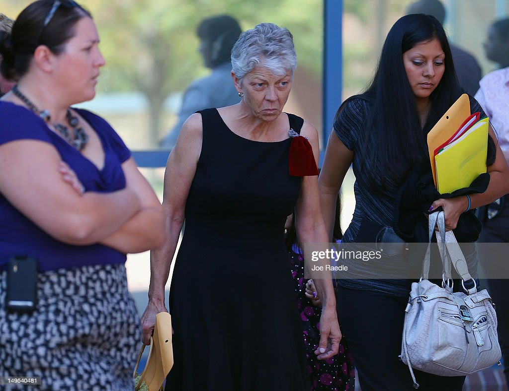 Cheryl Wygal (C), the mother of Rebecca Wingo, who was killed during the shooting at the screening of The Dark Knight Rises leaves the Arapahoe County Courthouse after attending an arraignment hearing for suspect James Holmes on July 30, 2012 in Centennial, Colorado. James Holmes, 24, who is accused of killing 12 people and injuring 58 in a shooting spree July 20, during a screening of 'The Dark Knight Rises.' in Aurora, Colorado was charged with 24 counts of first-degree murder and 116 counts of attempted murder.
