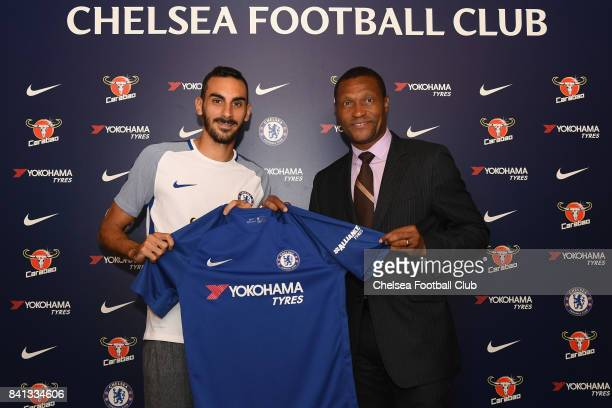 Chesea technical director Michael Emenalo welcomes new signing Davide Zappacosta on August 31 2017 in Cobham England