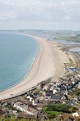 View from above of the long isthmus joining the Isle of Portland to mainland Dorset on the south coast of England.  Chesil Beach is a long line of pebbles and shingle separating the English Channel fr