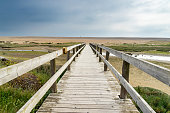 Wooden bridge to Chesil Beach near Weymouth and the Isle of Portland Dorset England UK