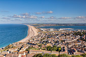 Chesil Beach and the town of Fortuneswell, Dorset, England, UK