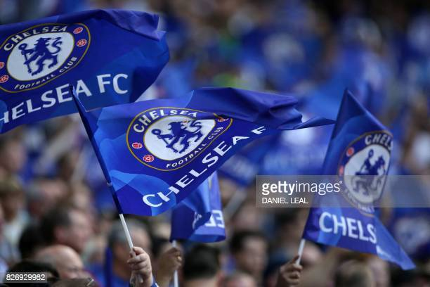 Cheslea supporters wave flags in the crowd ahead of the English FA Community Shield football match between Arsenal and Chelsea at Wembley Stadium in...