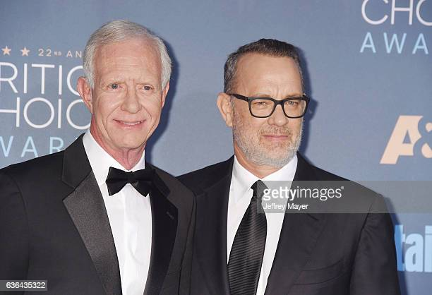 Chesley 'Sully' Sullenberger and actor Tom Hanks arrive at The 22nd Annual Critics' Choice Awards at Barker Hangar on December 11 2016 in Santa...
