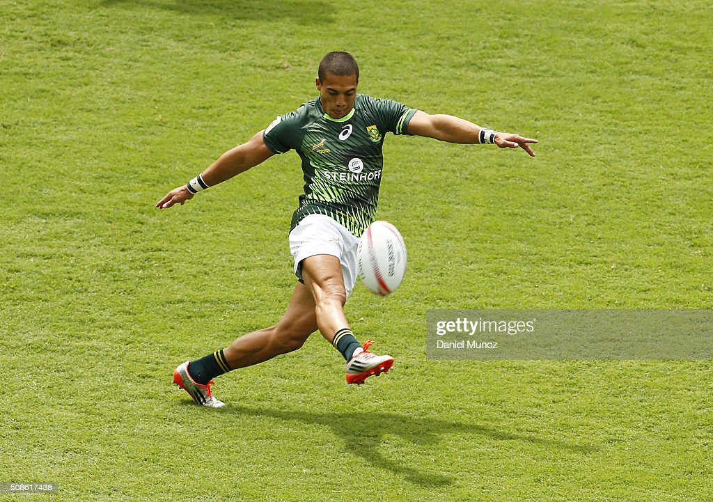 Cheslin Kolbe of South Africa kicks the ball during the 2016 Sydney Sevens match between Scotland and South Africa at Allianz Stadium on February 6, 2016 in Sydney, Australia.