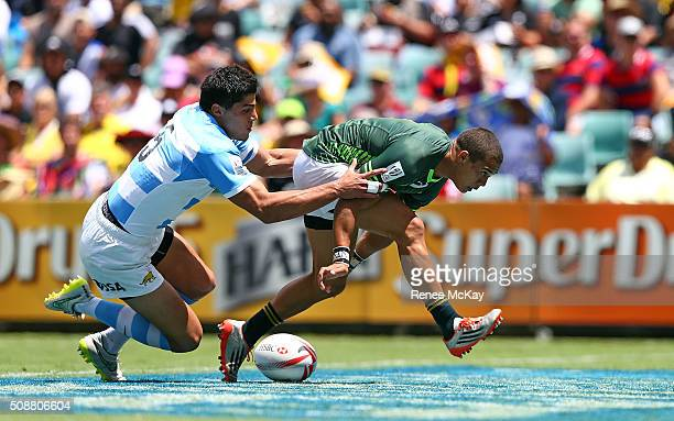 Cheslin Kolbe of South Africa scores a try in the tackle of Axel Muller of Argentina during the HSBC Sydney Sevens match between South Africa and...