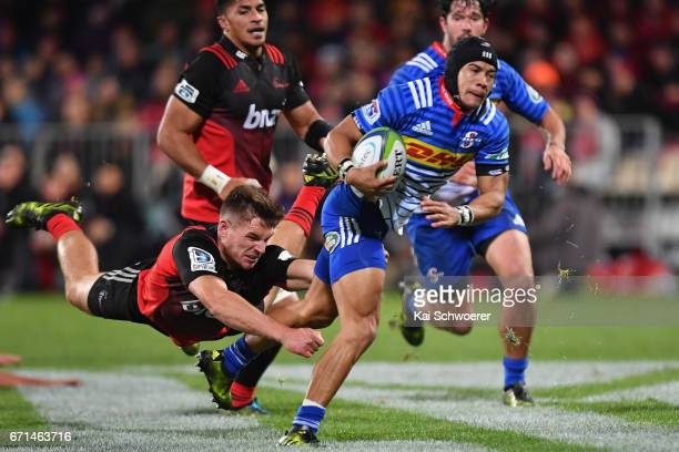 Cheslin Kolbe of the Stormers is tackled George Bridge of the Crusaders during the round nine Super Rugby match between the Crusaders and the...
