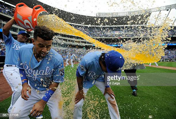 Cheslor Cuthbert and Raul Mondesi of the Kansas City Royals are doused with Gatorade by Salvador Perez as they celebrate a 71 win against the Toronto...