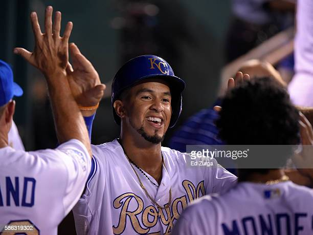 Cheslor Cuthbert of the Kansas City Royals celebrates with teammates after scoring on a Lorenzo Cain of the Kansas City Royals triple in the fifth...