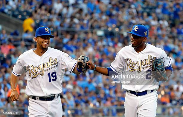 Cheslor Cuthbert of the Kansas City Royals congratulates Alcides Escobar on a play during the game against the Detroit Tigers at Kauffman Stadium on...