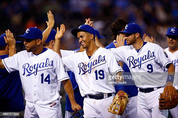Cheslor Cuthbert of the Kansas City Royals congratulates teammates after tthe Royals defeated the Detroit Tigers 121 to win the game against the...