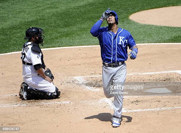 Cheslor Cuthbert of the Kansas City Royals crosses home plate after hitting a home run against the Chicago White Sox during the third inning on June...