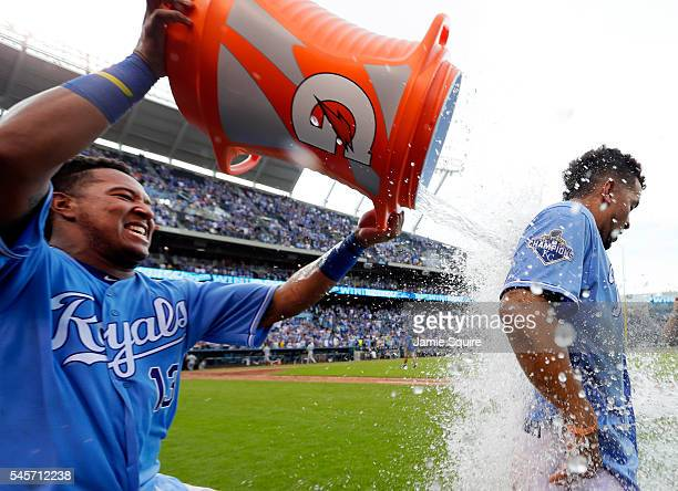 Cheslor Cuthbert of the Kansas City Royals is doused with a bucket of water by catcher Salvador Perez after the Roylas defeated the Seattle Mariners...