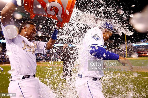 Cheslor Cuthbert of the Kansas City Royals is doused with water by Salvador Perez after the Royals defeated the Atlanta Braves 51 to win the game on...