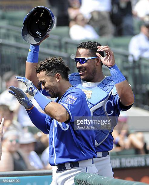 Cheslor Cuthbert of the Kansas City Royals is greeted by Salvador Perez after hitting a home run against the Chicago White Sox during the eighth...