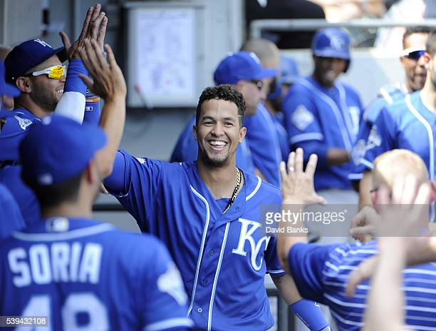 Cheslor Cuthbert of the Kansas City Royals is greeted by teammates after hitting a home run against the Chicago White Sox during the eighth inning on...