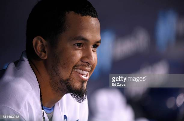 Cheslor Cuthbert of the Kansas City Royals sits in the dugout as he watches a game against the Minnesota Twins in the fifth inning at Kauffman...