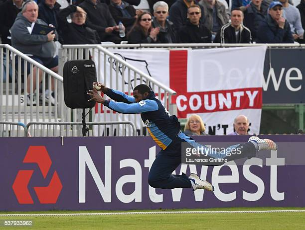Chesney Hughes of Derbyshire dives to take a catch to claim the wicket of Kevin O'Brien of Leicester Foxes during the NatWest T20 Blast match between...
