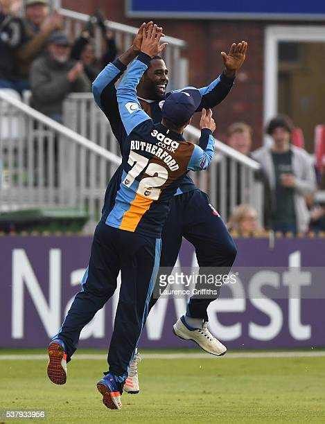 Chesney Hughes of Derbyshire is congratulated by Hamish Rutherford on his catch to claim the wicket of Kevin O'Brien of Leicester Foxes during the...