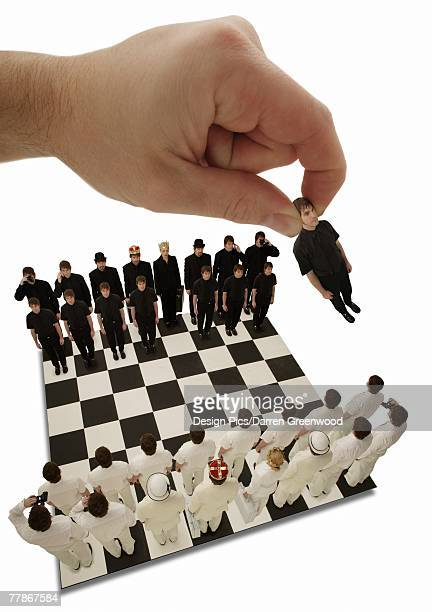 Chess being played with little people