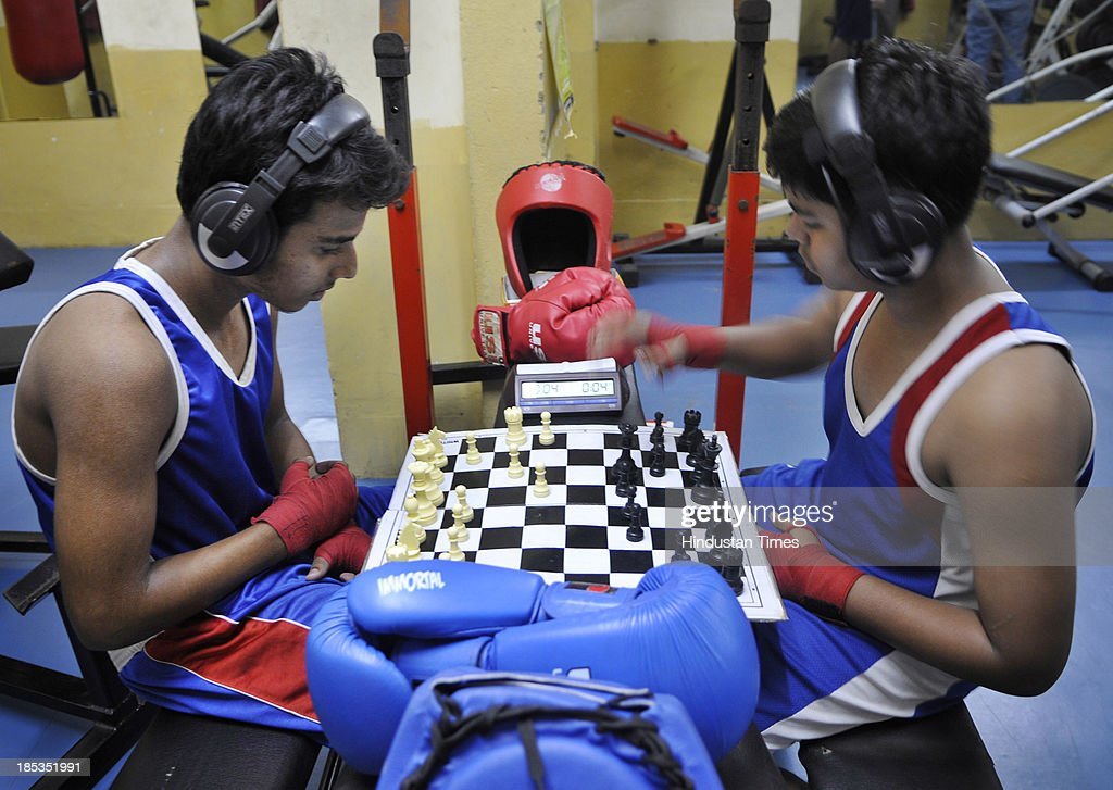 Chess Boxers in action during a training session at New Alipur on October 19, 2013 in Kolkata, India. Invented by French artist and filmmaker Enki Bilal, Chess boxing is a hybrid sport that combines chess with boxing in alternating rounds.