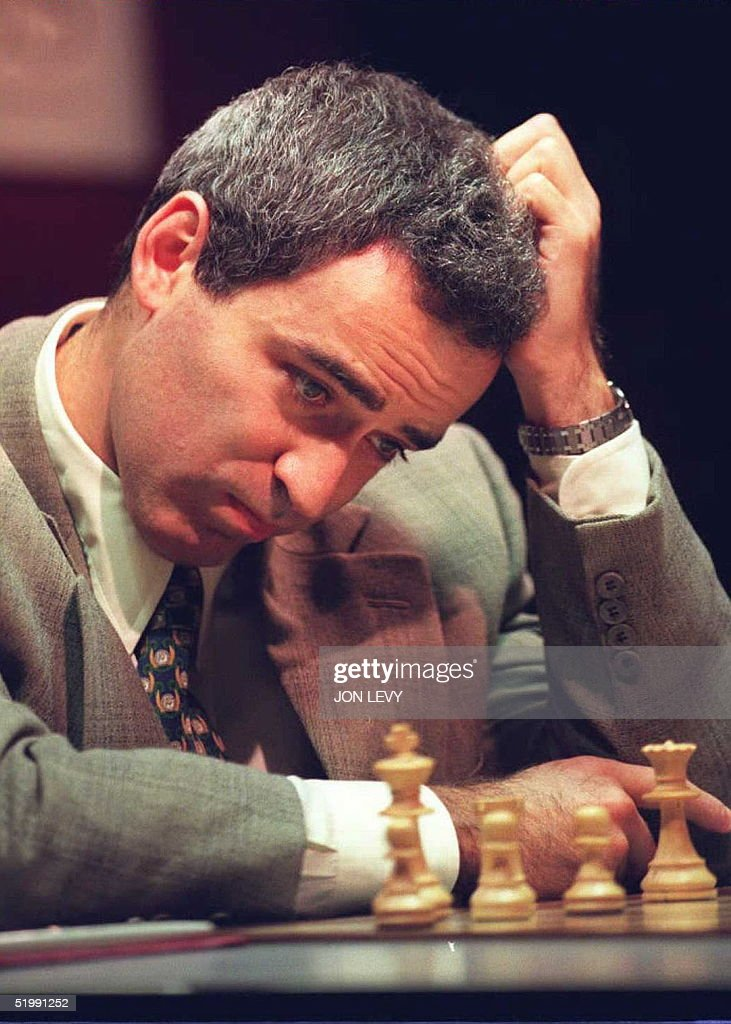 Chess challenger Gary Kasparov scratches his head 26 September in New York at the start of the tenth game with Indian player Vishi Anand. Anand won the ninth game 25 September for a 5-4 lead over Kasparov. AFP PHOTO