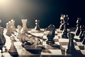 Chess financial business strategy concept. King loses the fight