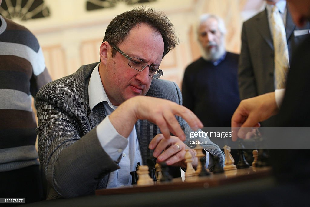 Chess Grandmaster Boris Gelfand analyses his match with Veselin Topalov immediately after its conclusion at the World Chess London Grand Prix at Simpson's-in-the-Strand on September 22, 2012 in London, England. The event, which begins the 2012/13 World Chess Championship Cycle, runs until October 3, 2012 and takes place over 11 rounds. The London Grand Prix is the first tournament in an ambitious, high-profile rebranding of world chess by American-born entrepreneur Andrew Paulson whose intention is to regain the global popularity chess enjoyed in the 1970s with matches between American Bobby Fischer and the Soviet Union's Boris Spassky.