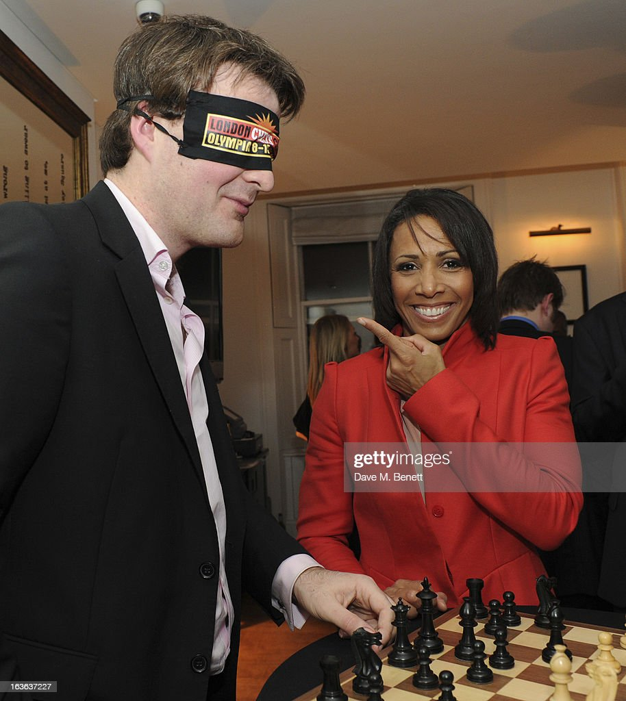 Chess grandmaster Gawain Jones and Dame <a gi-track='captionPersonalityLinkClicked' href=/galleries/search?phrase=Kelly+Holmes&family=editorial&specificpeople=213496 ng-click='$event.stopPropagation()'>Kelly Holmes</a> attend the launch of the 'Urban Chess' Funding Initiative from East Village at Mortons on March 13, 2013 in London England.