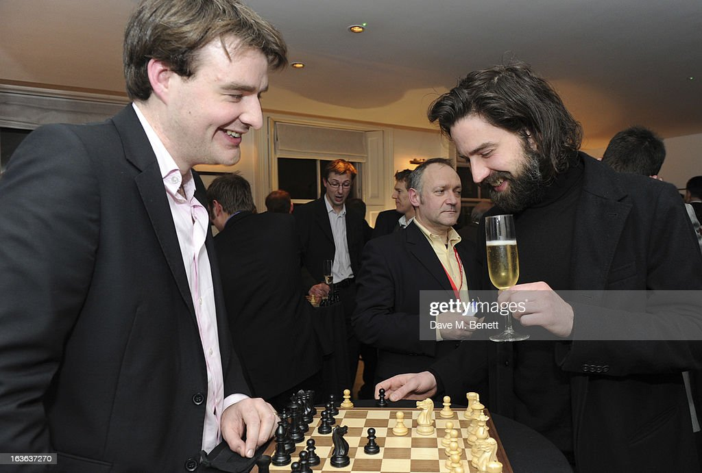 Chess grandmaster Gawain Jones and Jack Guinness attend the launch of the 'Urban Chess' Funding Initiative from East Village at Mortons on March 13, 2013 in London England.