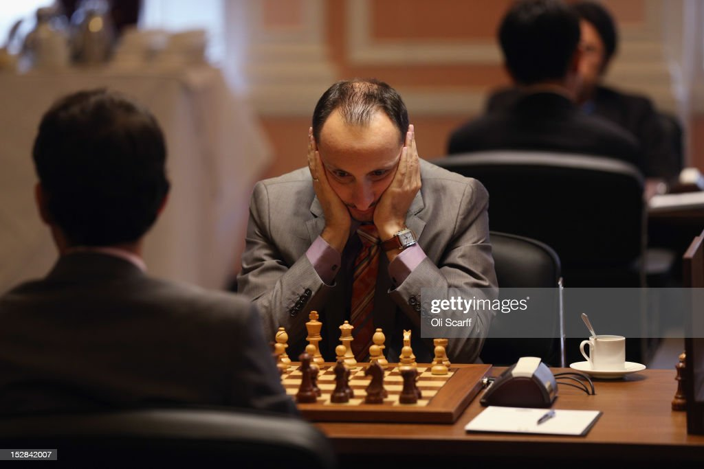 Chess Grandmaster <a gi-track='captionPersonalityLinkClicked' href=/galleries/search?phrase=Veselin+Topalov&family=editorial&specificpeople=2093743 ng-click='$event.stopPropagation()'>Veselin Topalov</a> plays in round 6 of the World Chess London Grand Prix at Simpson's-in-the-Strand on September 27, 2012 in London, England. The event, which begins the 2012/13 World Chess Championship Cycle, runs until October 3, 2012 and takes place over 11 rounds. The London Grand Prix is the first tournament in an ambitious, high-profile rebranding of world chess by American-born entrepreneur Andrew Paulson whose intention is to regain the global popularity chess enjoyed in the 1970s with matches between American Bobby Fischer and the Soviet Union's Boris Spassky.