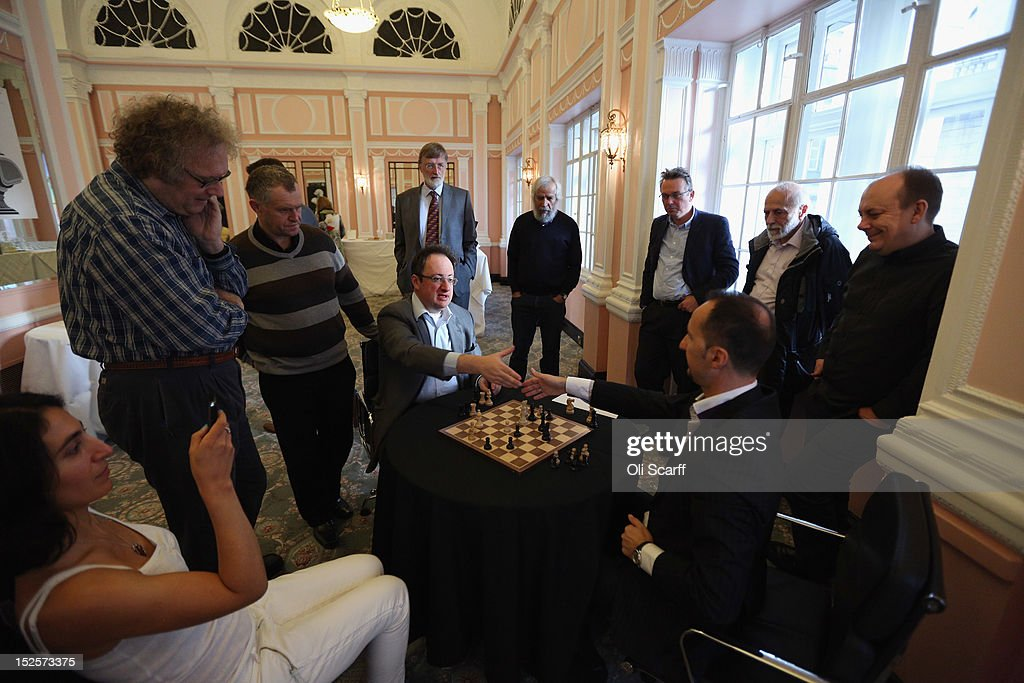 Chess Grandmasters <a gi-track='captionPersonalityLinkClicked' href=/galleries/search?phrase=Boris+Gelfand&family=editorial&specificpeople=790712 ng-click='$event.stopPropagation()'>Boris Gelfand</a> (C) and <a gi-track='captionPersonalityLinkClicked' href=/galleries/search?phrase=Veselin+Topalov&family=editorial&specificpeople=2093743 ng-click='$event.stopPropagation()'>Veselin Topalov</a> (3rd R) analyse their match immediately after its conclusion at the World Chess London Grand Prix at Simpson's-in-the-Strand on September 22, 2012 in London, England. The event, which begins the 2012/13 World Chess Championship Cycle, runs until October 3, 2012 and takes place over 11 rounds. The London Grand Prix is the first tournament in an ambitious, high-profile rebranding of world chess by American-born entrepreneur Andrew Paulson whose intention is to regain the global popularity chess enjoyed in the 1970s with matches between American Bobby Fischer and the Soviet Union's Boris Spassky.