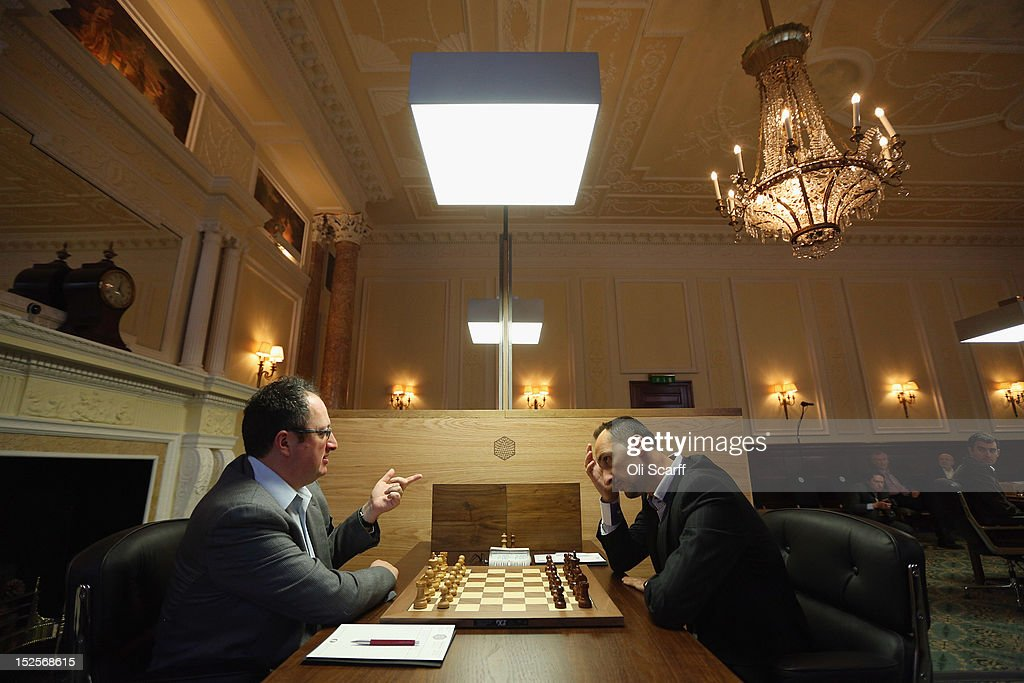 Chess Grandmasters <a gi-track='captionPersonalityLinkClicked' href=/galleries/search?phrase=Boris+Gelfand&family=editorial&specificpeople=790712 ng-click='$event.stopPropagation()'>Boris Gelfand</a> (L) plays <a gi-track='captionPersonalityLinkClicked' href=/galleries/search?phrase=Veselin+Topalov&family=editorial&specificpeople=2093743 ng-click='$event.stopPropagation()'>Veselin Topalov</a> in the World Chess London Grand Prix at Simpson's-in-the-Strand on September 22, 2012 in London, England. The event, which begins the 2012/13 World Chess Championship Cycle, runs until October 3, 2012 and takes place over 11 rounds. The London Grand Prix is the first tournament in an ambitious, high-profile rebranding of world chess by American-born entrepreneur Andrew Paulson whose intention is to regain the global popularity chess enjoyed in the 1970s with matches between American Bobby Fischer and the Soviet Union's Boris Spassky.